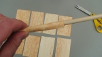 "Roll a piece of the paper over a 5/16"" wooden dowel."