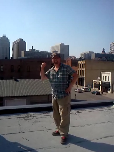 Standing on the roof on top of restaurant where Ecological Gardens is installing a garden